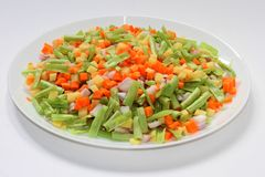 Fresh vegetable slices in a plate. With white background Royalty Free Stock Photos