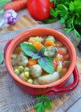 Fresh vegetable soup with bean, carrot, potato, tomato in bowl Royalty Free Stock Image