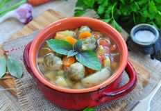 Fresh vegetable soup with bean, carrot, potato, tomato in bowl Stock Photo