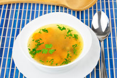 Fresh vegetable soup on blue tablecloth Royalty Free Stock Image