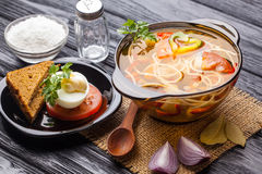 Fresh vegetable soup with noodles in a pot on black Stock Photo