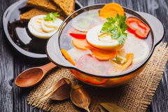 Fresh vegetable soup in a pot on black background Royalty Free Stock Photo