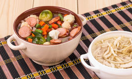 Fresh vegetable soup with sausage and chicken. Stock Image