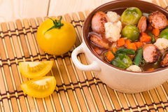 Fresh vegetable soup with sausage. Stock Photography