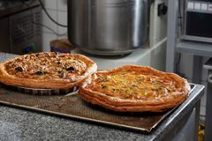 Fresh vegetable tart removed from the oven at the bakery.  Stock Image