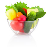 Fresh vegetable in transparent bowl  on white background Stock Photos