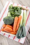 Fresh vegetable on a tray. Organic vegetable, carrot, broccoli, leek on a tray Stock Photos