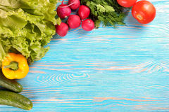 Fresh vegetable on wooden background. Fresh vegetables on blue wooden background. top view Stock Photography