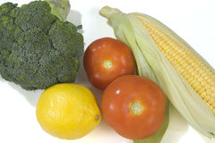 Fresh vegetables. Assorted fresh vegetables including broccoli, corn, lemon and tomatoes Royalty Free Stock Photo