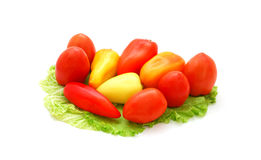 Fresh vegetables. Fresh pepper, tomatoes and lettuce isolated on a white background Stock Image