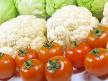 Fresh vegetables. Close up of fresh tomatoes and cauliflowers royalty free stock photo