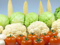 Fresh vegetables. Fresh tomatoes, broccoli and corns royalty free stock photo
