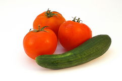 Fresh vegetables. Cucumber and tomatoes on white background Royalty Free Stock Photography