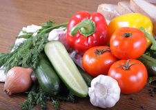Fresh vegetables. Tomatoes, cucumbers, garlic and others on a wooden table Stock Photo