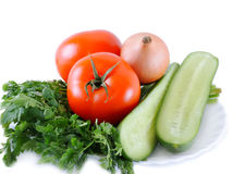 Fresh vegetables. Tomatoes, cucumbers, garlic and others on a white background Stock Image