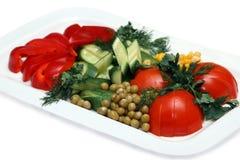 Fresh Vegetables. Multi-coloured fresh vegetables on a plate Stock Photo