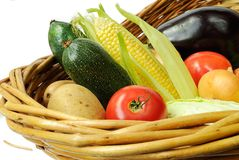 Fresh vegetables. In a basket isolated on white background Stock Photos