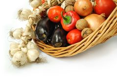 Fresh vegetables. In a basket on white background Stock Photography