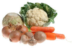 Fresh Vegetables. Fresh organic vegetables including cauliflower, celeriac, carrots, onions and mushrooms Royalty Free Stock Image
