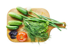 Fresh vegetables. Are on the cutting board isolated on white background Royalty Free Stock Image