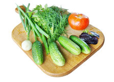 Fresh vegetables. Are on the cutting board isolated on white background Royalty Free Stock Images
