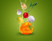 Fresh vegetables. With water splashes on blue background Stock Photo