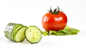 Fresh vegetables. Tomato, cucumber and lettuce salad on the white background Stock Photo