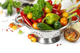 Fresh vegetables. In metal colander over white Royalty Free Stock Images