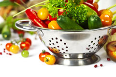 Fresh vegetables. In metal colander over white Royalty Free Stock Photography