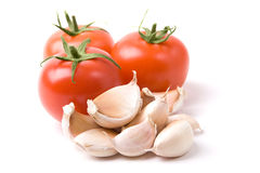 Fresh vegetables. A photo of garlic and fresh red tomatoes Stock Images