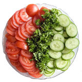 Fresh vegetables. A plate of fresh tomatoes, cucumber and parsley Royalty Free Stock Photography