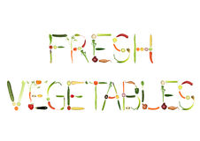 Fresh Vegetables. Vegetable selection spelling the words fresh vegetables, over white background Royalty Free Stock Photo