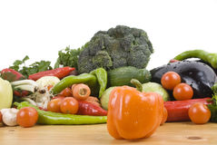 Fresh vegetables. On wood table ,orange pepper in front of image.Check out also stock images
