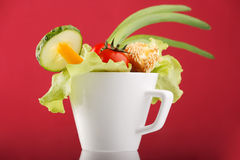 Fresh vegetables. In the cup Royalty Free Stock Image