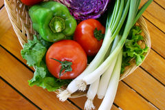 Fresh vegetables. Cornucopia of fresh veggies in a basket Stock Photos
