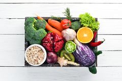 Free Fresh Vegetables And Fruits In A Wooden Box On A White Wooden Background. Organic Food. Stock Images - 151179044
