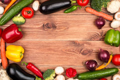 Fresh vegetables as frame on the rustic background. Royalty Free Stock Photography