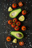 Fresh vegetables. Avocado, tomatoes, lime, peppers and sea salt royalty free stock photos
