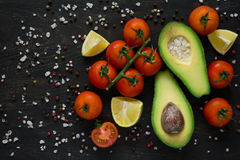 Fresh vegetables. Avocado, tomatoes, lime, peppers and sea salt royalty free stock photo
