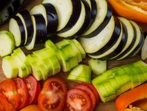 fresh vegetables background as eggplant, tomatoe, zucchini, bell pepperб ratatouille royalty free stock photos