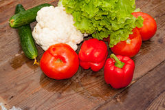 Fresh vegetables on the background of a wooden table royalty free stock image