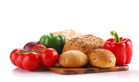Fresh vegetables and bakery products on breadboard. Composition with vegetables and bakery products on breadboard Royalty Free Stock Photos