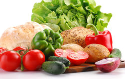 Fresh vegetables and bakery products on breadboard. Composition with vegetables and bakery products on breadboard Stock Image