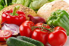 Fresh vegetables and bakery products on breadboard Stock Images