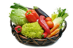 Fresh vegetables in the basket. Different fresh vegetables in the basket on white background Royalty Free Stock Image