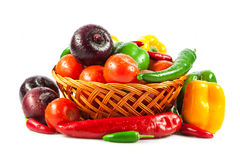 Fresh vegetables in basket isolated on white. Bio Vegetable.  Co. Mposition with raw vegetables and basket isolated on white Stock Image