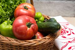 Fresh vegetables in basket. Tomato, cucumber, pepper and lettuce. Fresh vegetables covered with water drops in basket. Organic Tomatoes, cucumber, pepper and Stock Photo