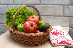 Fresh vegetables in basket. Tomato, cucumber, pepper and lettuce. Fresh vegetables covered with water drops in basket. Organic Tomatoes, cucumber, pepper and Royalty Free Stock Images