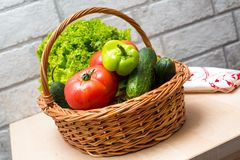 Fresh vegetables in basket. Tomato, cucumber, pepper and lettuce. Fresh vegetables covered with water drops in basket. Organic Tomatoes, cucumber, pepper and Royalty Free Stock Photos