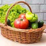 Fresh vegetables in basket. Tomato, cucumber, pepper and lettuce. Fresh vegetables covred with water drops in basket. Organic Tomatoes, cucumber, pepper and Royalty Free Stock Photos